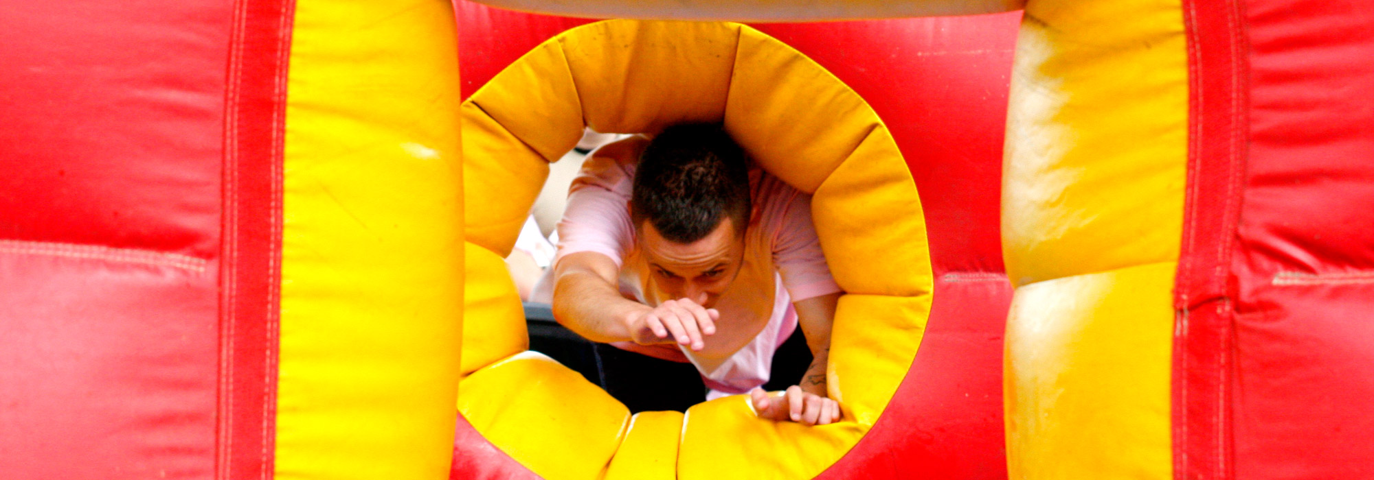 Climbing through an inflatable on It's a knockout
