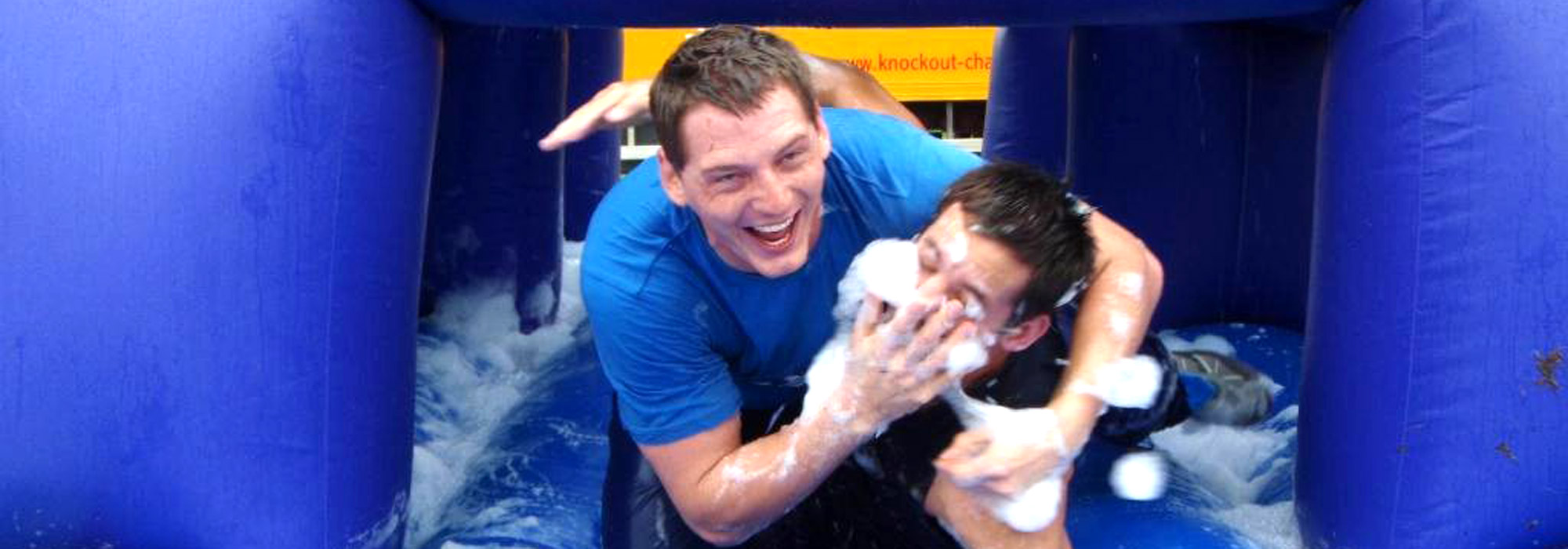 Two young men having fun in the bubbles