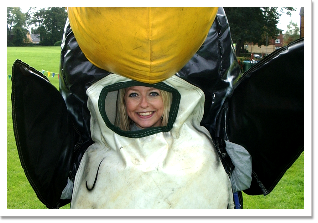 A young woman dressed in one of our sumo penguin suits