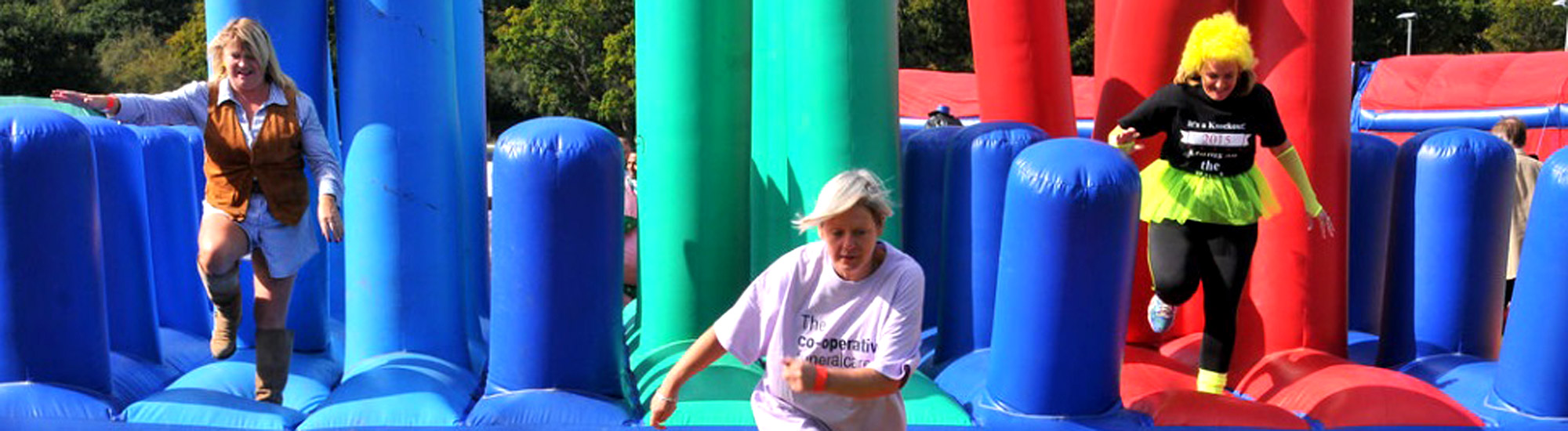 Running across our Bondi Bash inflatable