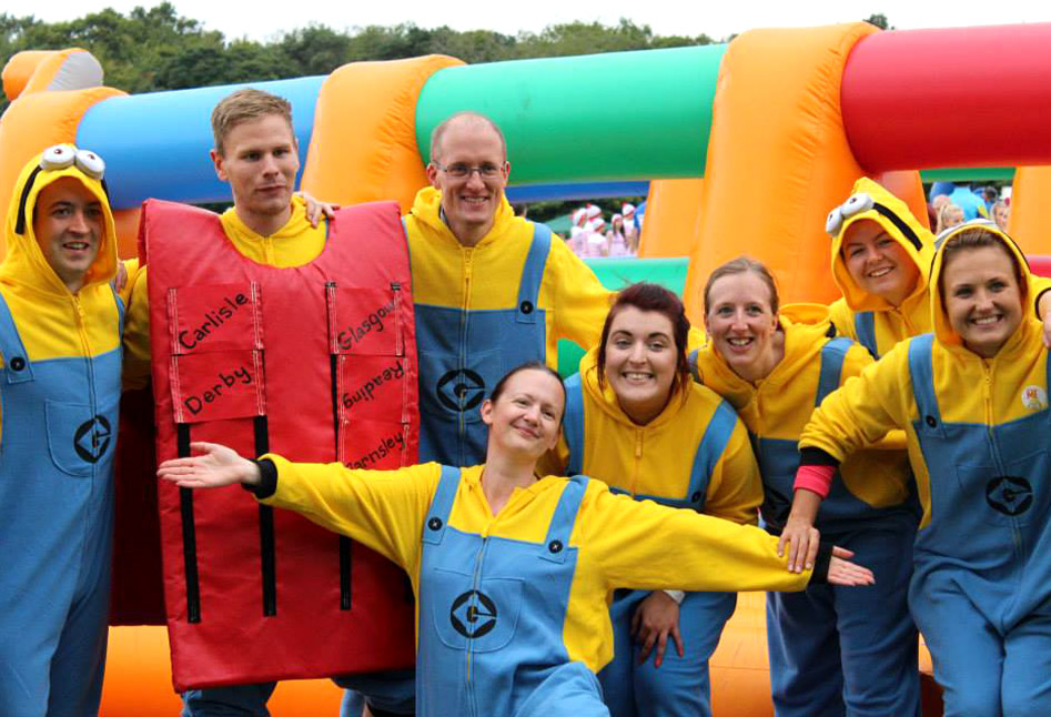 A team dressed as Minions at a charity event