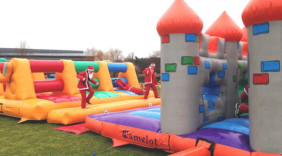 santa's running through inflatable obstacles